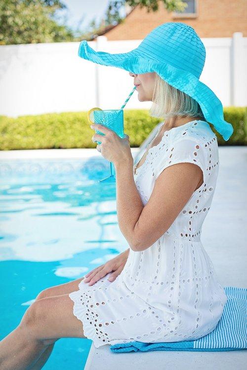 woman  poolside  drinking