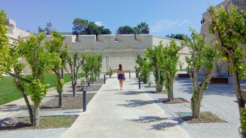 woman walking mdina