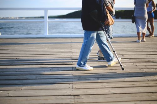 woman crutch old