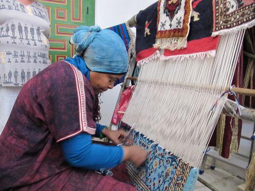 woman carpet tying
