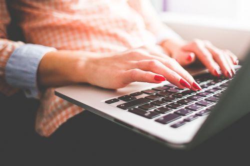 woman typing writing