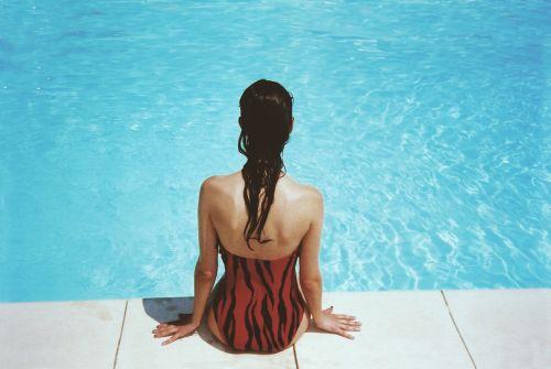 woman sitting poolside