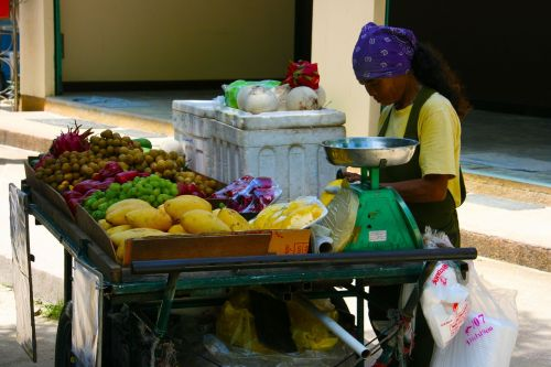 woman food stall fruits