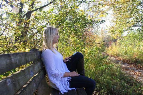 woman thinking bench