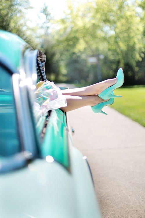 woman's legs high heels vintage car