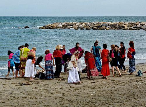 women dance beach
