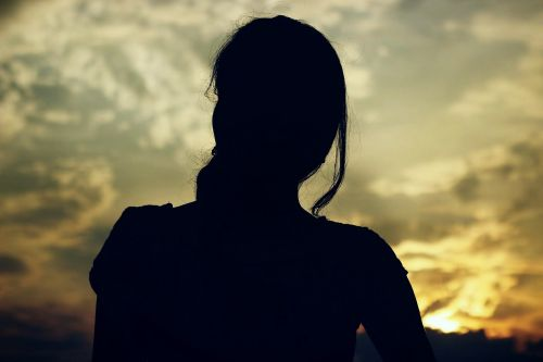 women sunset silhouette