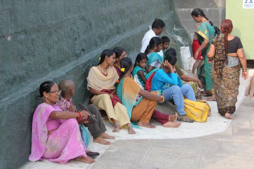 women waiting sari
