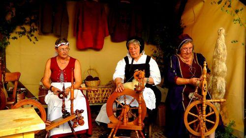 women spin spinning wheel