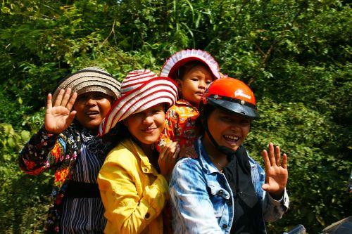women motorbike ride smiling
