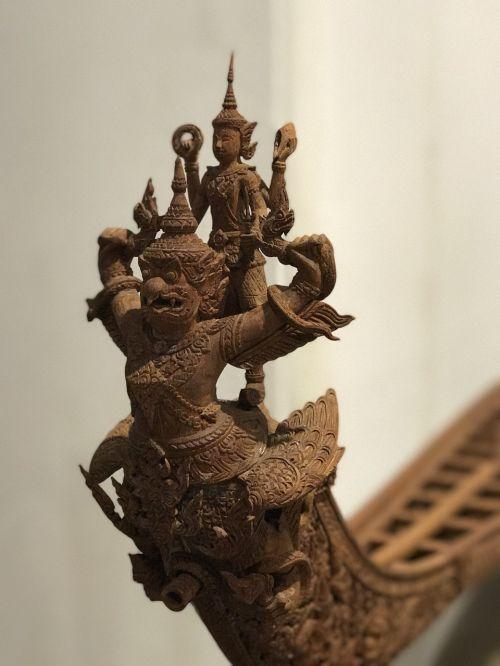 wood carving royal barge vishnu