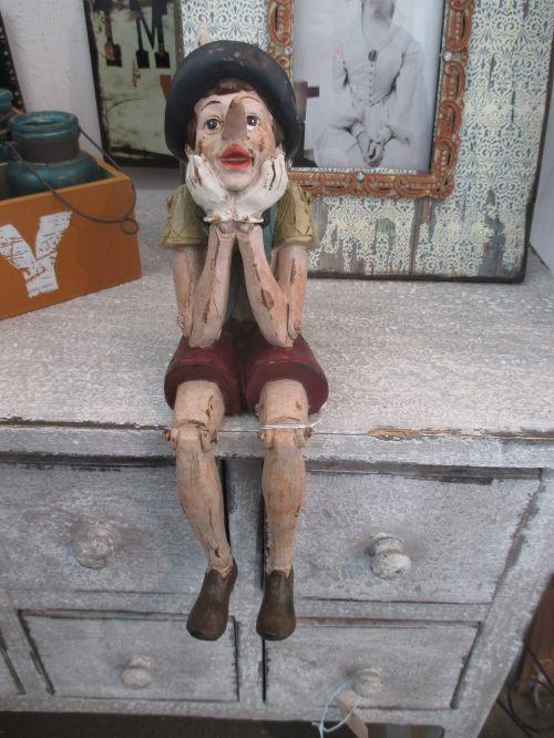 wood doll melancholy perplexity