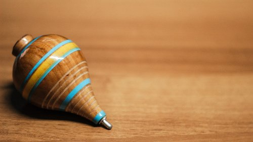 wooden  spinning top  top