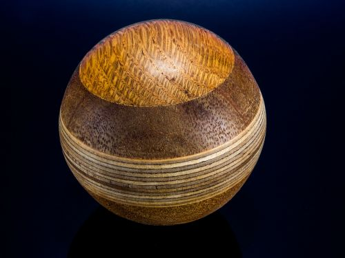 wooden ball turned hand labor