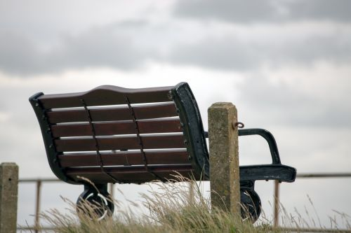 Wooden Bench In Clouds