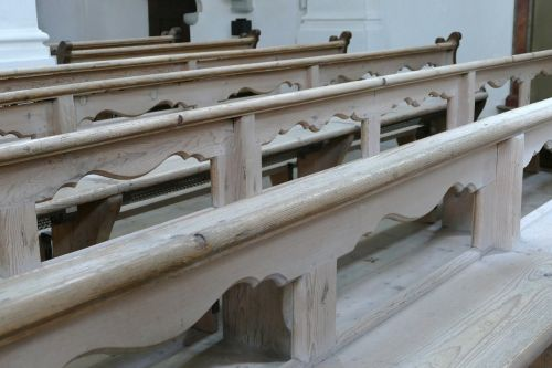 wooden benches stalls pew