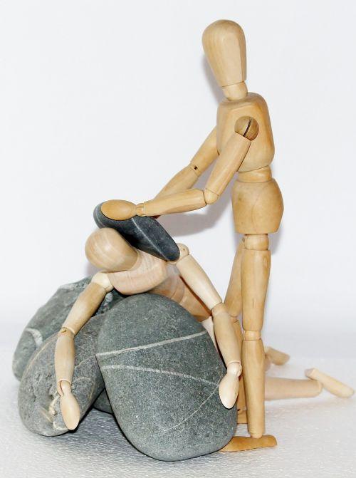 wooden figures stones plunge