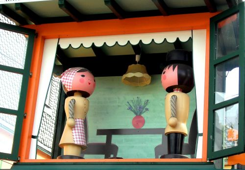 wooden figures pair turned to two figures
