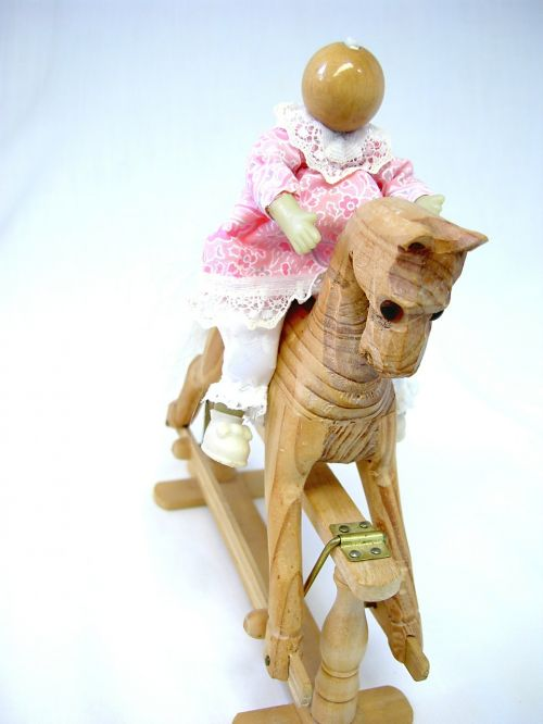 wooden horse rocking horse doll