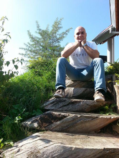 wooden ladders man sitting