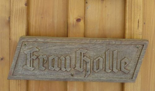 wooden sign fairy tales mrs holle