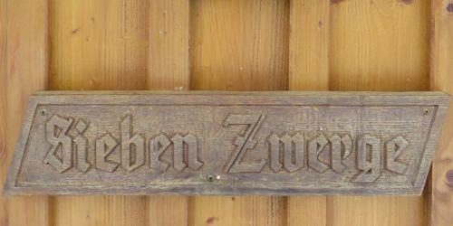 wooden sign fairy tales seven dwarfs
