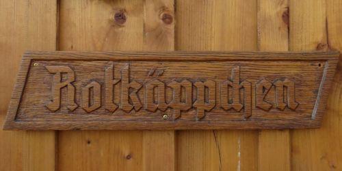 wooden sign fairy tales rotkäppchen