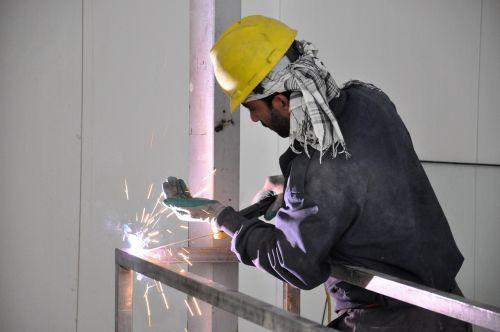 workers weld welder