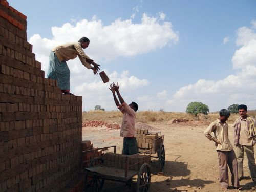 workers country-side brick-laying
