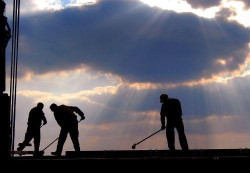 workers brooms mops