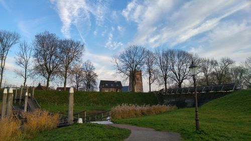 woudrichem,woerkem,dr tinus,nature,air,trees,skies,blue sky,background,church,clouds,landscape holland