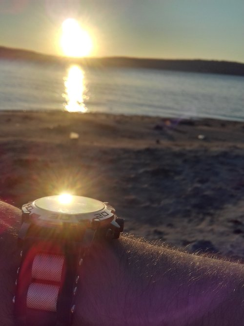 wristwatch  sea  sun