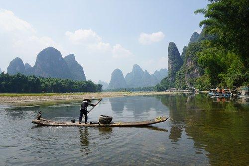 xingping  bamboo raft  fishman