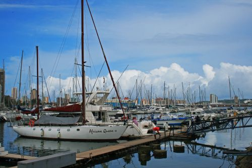 Yachts With Cloud & City Background