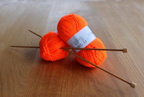 yarn orange knitting needles