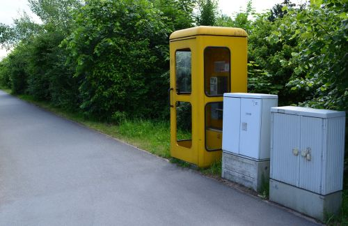 yellow phone phone booth