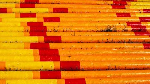 yellow and orange poles  horse jump poles  coloured poles