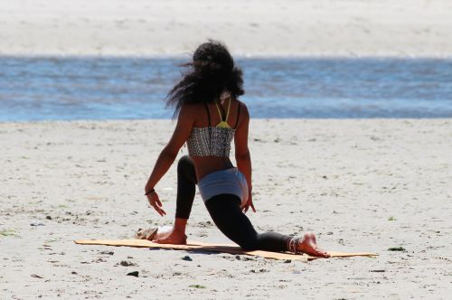 yoga woman beach