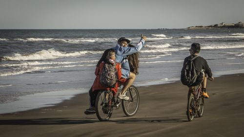young bicycles beach