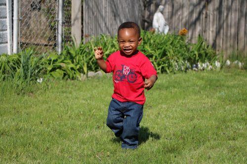young boy playing playing running