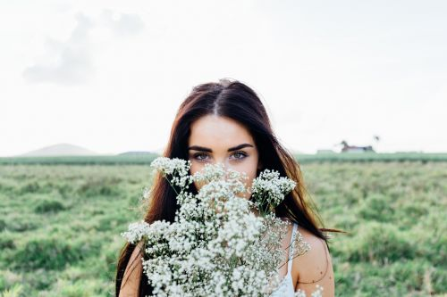 young woman flowers bouquet woman