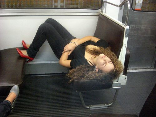 young woman sleeping on the subway pretty