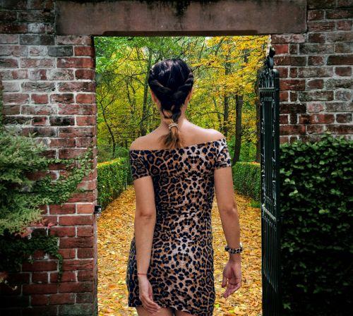 Young Woman Enters Autumn Garden