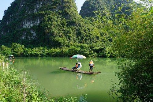 yulong river  boat  bamboo raft